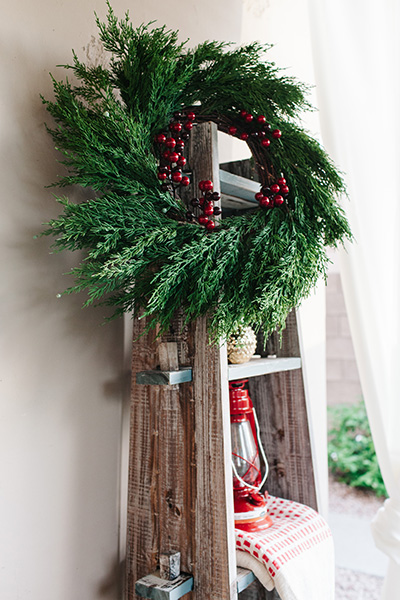 holiday wreath on ladder