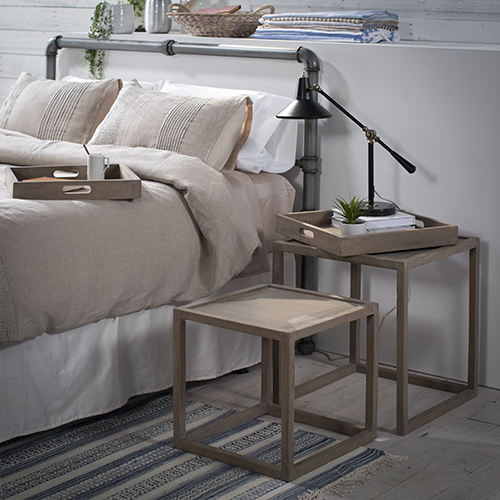 Wood Nesting Side Table Next To Bed