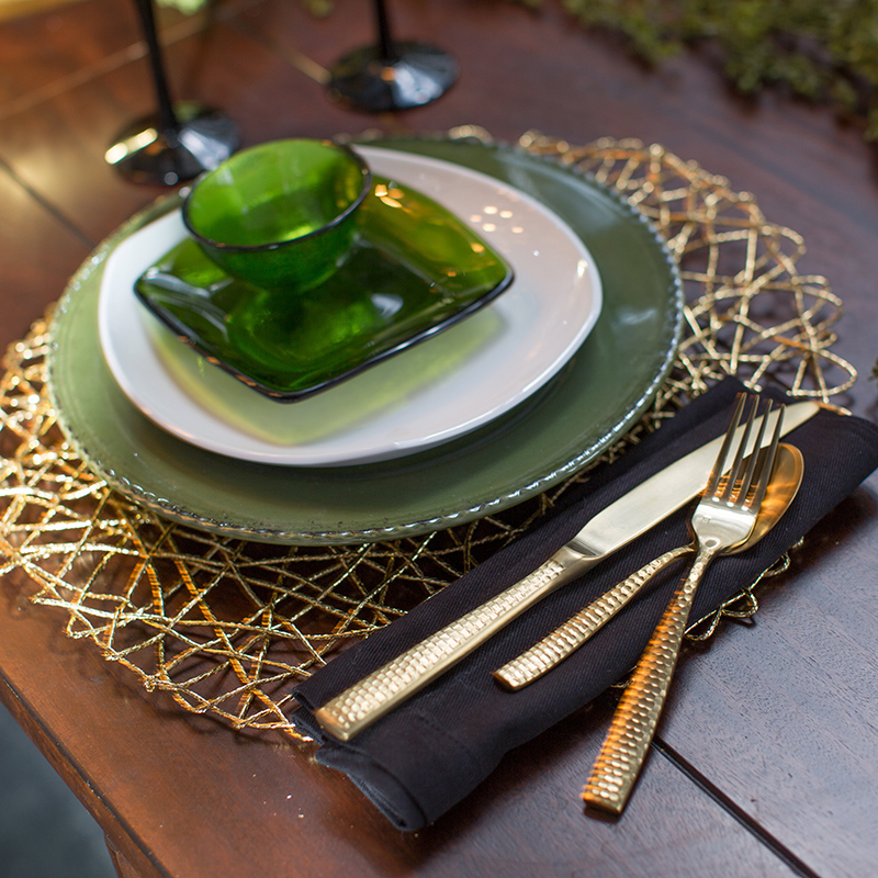 place setting with black napkin
