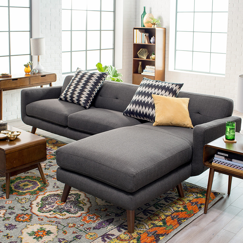 Gray mid-century modern sofa with chaise