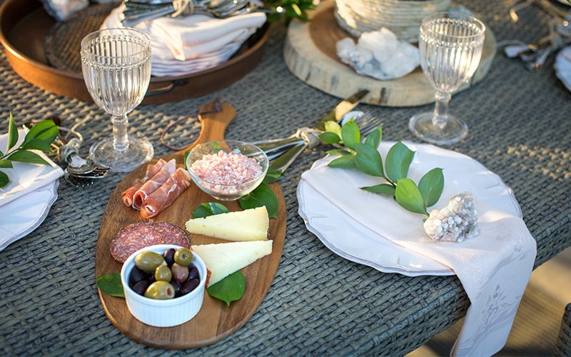 outdoor dining with cheese and meat platter