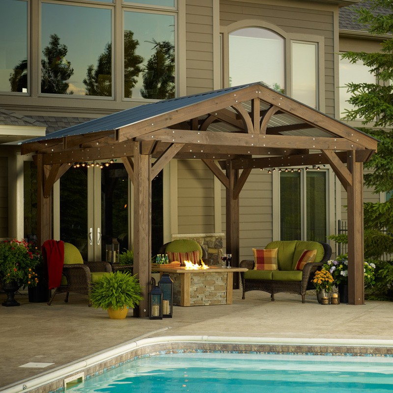 wood pergola with roof next to house