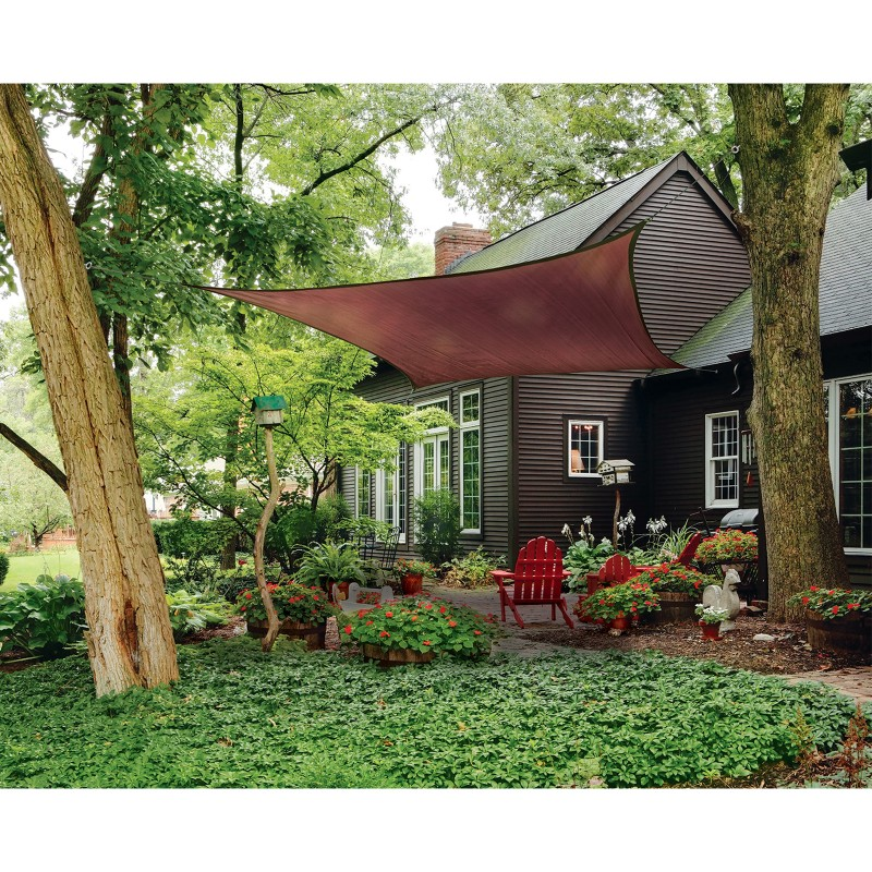 shade sail in trees covering patio