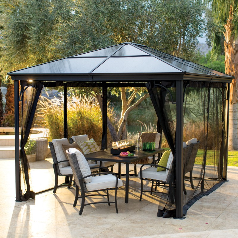 gazebo with netting and patio dining set