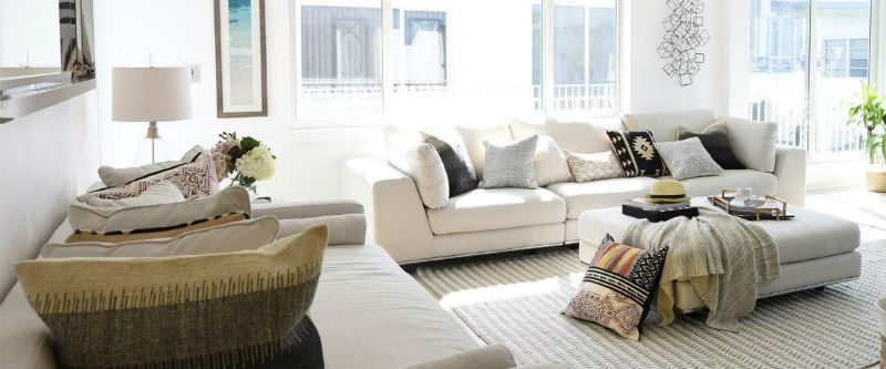 Transitional living room with white furniture and decor