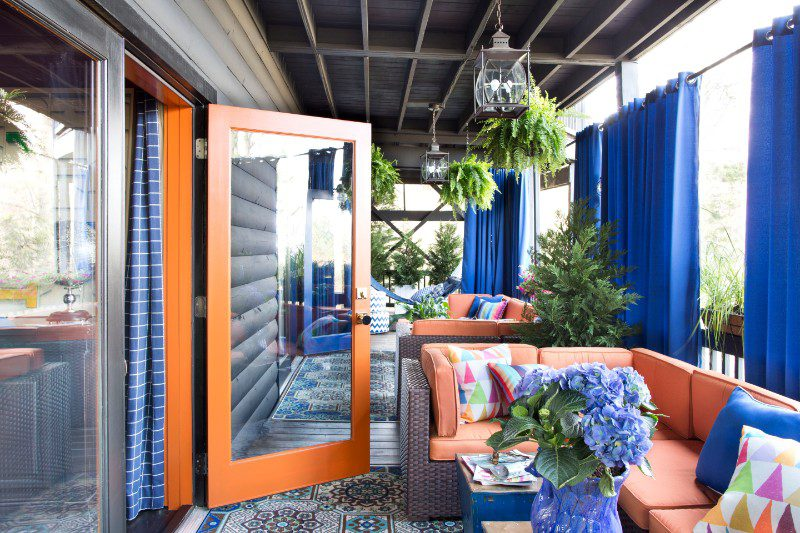 blue outdoor curtains on covered deck