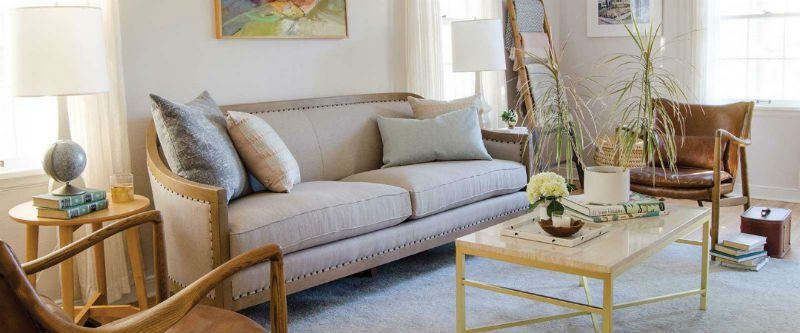 Living room with nailhead trim sofa and rustic leather arm chairs