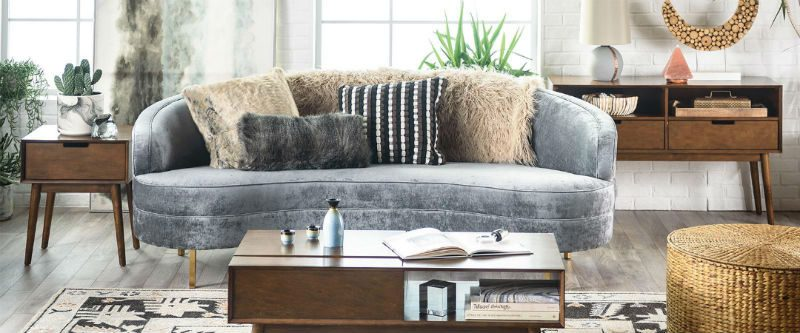 Eclectic living room with velvet sofa and textured accents