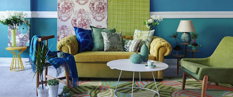 Tropical living room with lime green sofa and blue and teal decor