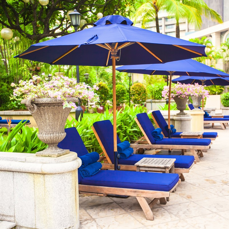 blue patio umbrellas with chaise lounges