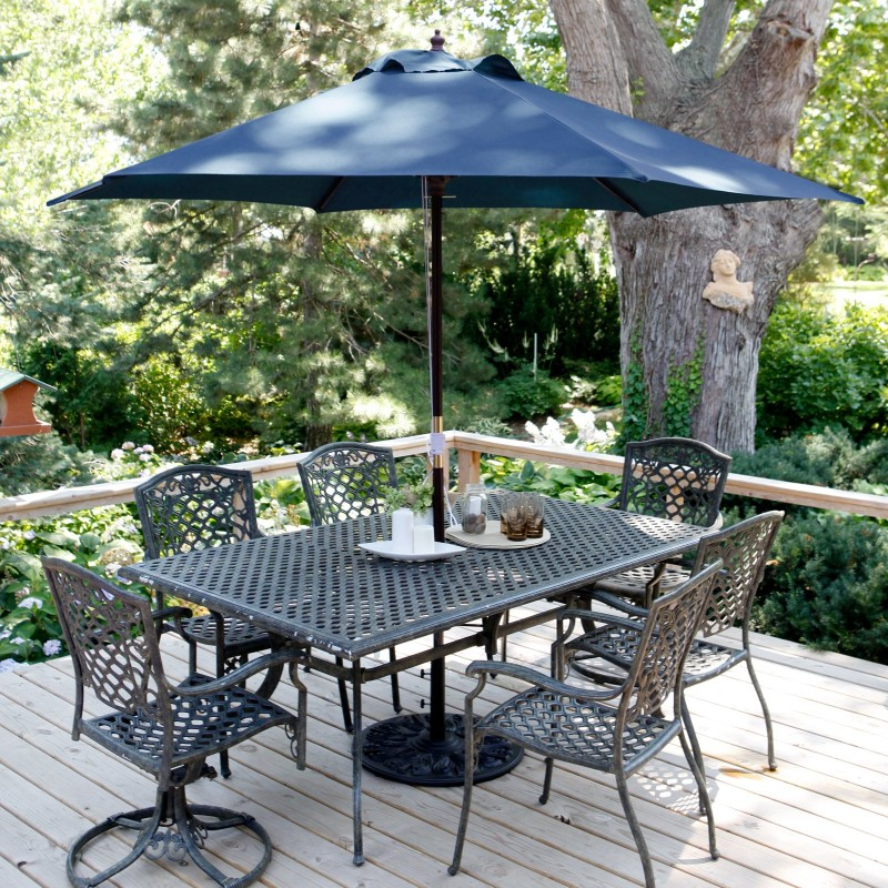 navy blue patio umbrella with black patio dining set on deck