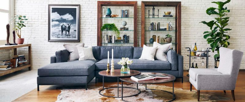 Living room with blue sectional and rustic-industrial decor
